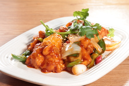 Tasty sweet and sour pork served in a white plate 版權商用圖片