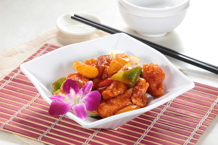 Tasty sweet and sour pork served in a white plate Stock Photo