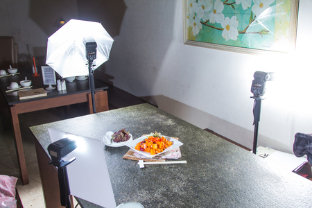 Photoshoot of a tasty sweet and sour pork served in a white plate