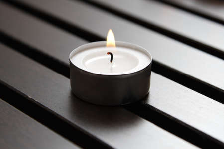 Tea light on a wooden bench