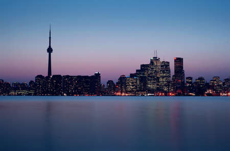 Toronto Skyline with downtown and CN Tower taken right after sunset in cold May Evening  photo