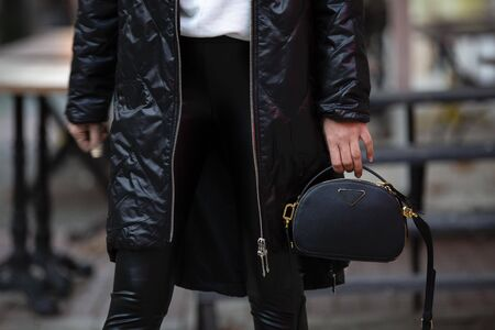 female model on outfit and leather bag