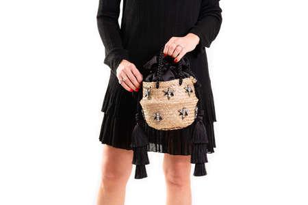 handmade straw hat and handbag, female model on white background