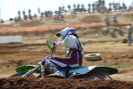 Motocross Rider using the berm to maintain momentum Stock Photo - 2354964