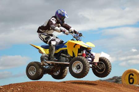 Quad bike racing, Airborne over a jump photo