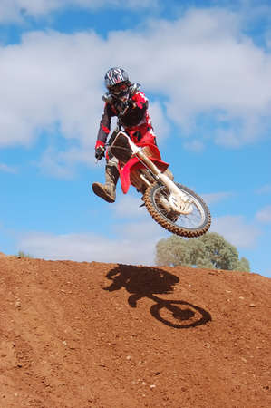 Motocross rider going over the drop off in style Stock Photo - 2354969