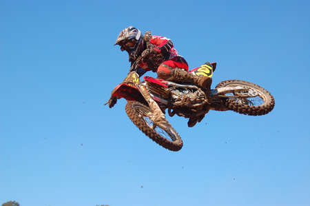 Motocross rider over a jump Stock Photo - 2463794