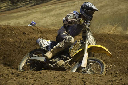 supercross: Motocross rider accelarating out of a corner Stock Photo