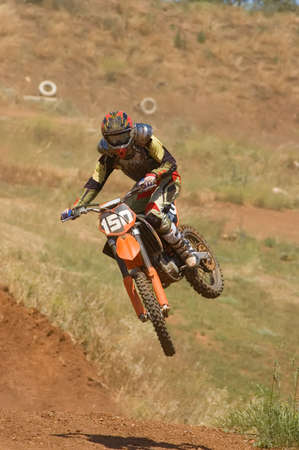 Motocross rider styling it up over a jump Stock Photo - 3121283