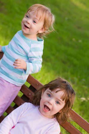 two young sisters having fun in the park photo