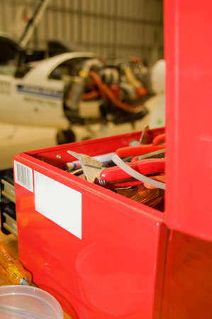 repaired: Aircraft being repaired focus on tools