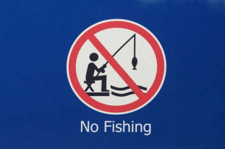 permitted: No fishing sign warning people fishing is not permitted in this area Stock Photo