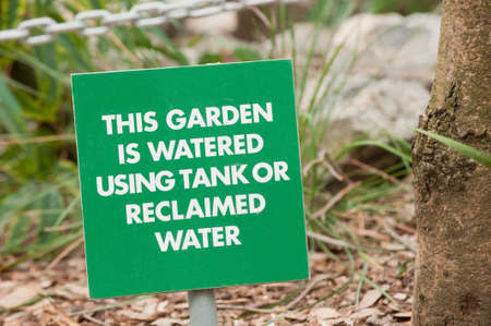 water tank: Sign in garden warning recycled water is in use