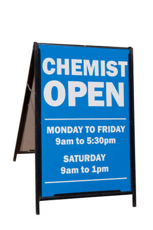 opening hours: Sandwich board advertising chemist opening hours Stock Photo