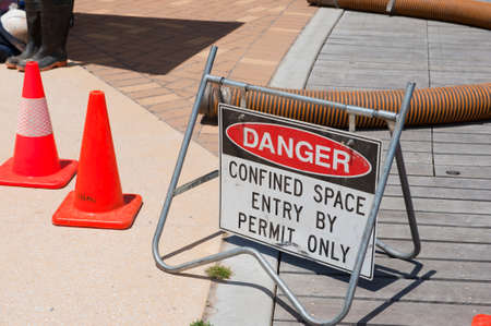 Sign warning of dangerous work underway Stock Photo
