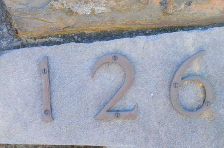 affixed: The number 126 affixed to a building exterior