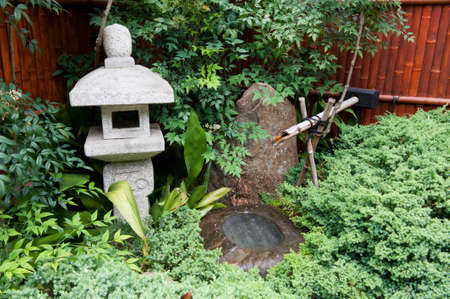 water feature: A Japanese garden scene featuring a water feature