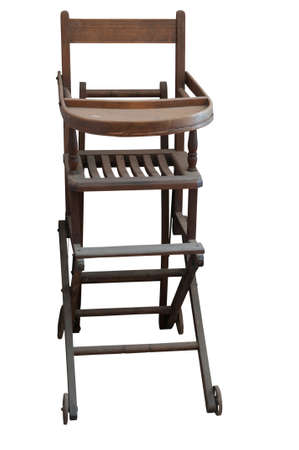 antique chair: An antique wooden high chair on a white background Stock Photo