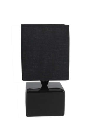 A black ceramic and fabric lamp on a white background photo