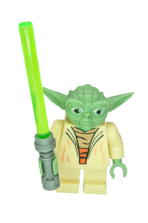 lego: ADELAIDE, AUSTRALIA - June 15 2014:A studio shot of a Yoda Lego Compatible minifigure from the movie series Star Wars. Lego is extremely popular worldwide with children and collectors. Editorial