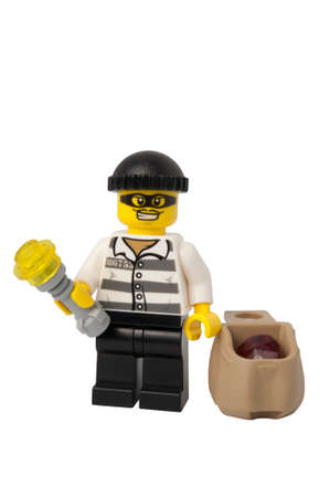 ADELAIDE, AUSTRALIA - September 11 2014:A studio shot of a Thief holding jewels Lego minifigure issued in the 2014 Lego Advent Calendar. Lego is extremely popular worldwide with children and collectors.