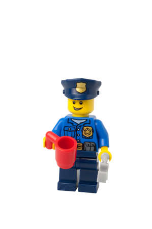 ADELAIDE, AUSTRALIA - September 11 2014:A studio shot of a Policeman holding a mug Lego minifigure issued in the 2014 Lego Advent Calendar. Lego is extremely popular worldwide with children and collectors.