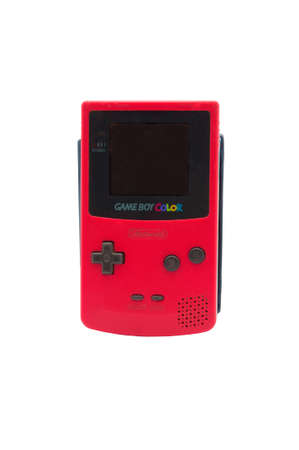 nintendo: ADELAIDE, AUSTRALIA - October 27 2014:A studio shot of a Nintendo Game Boy Colour. A popular handheld video game device which has sold over 100 million units worldwide.