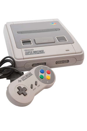 nintendo: ADELAIDE, AUSTRALIA - October 27 2014:A studio shot of a Super nintendo video game device. A popular  16-bit entertainment system sold worldwide during the 1990s.