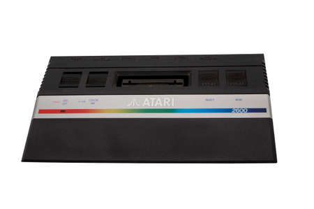 ADELAIDE,AUSTRALIA - October 27 2014:A studio shot of a vintage Atari 2600 gaming console. Initially released in 1977, Atari is credited with popularizing microprocessor-based hardware and cartridges with game code