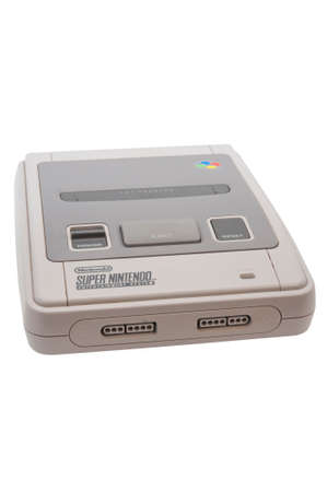 nintendo: ADELAIDE, AUSTRALIA - October 27 2014:A studio shot of a Super nintendo video game device. A popular  16-bit entertainment system sold worldwide during the 1990