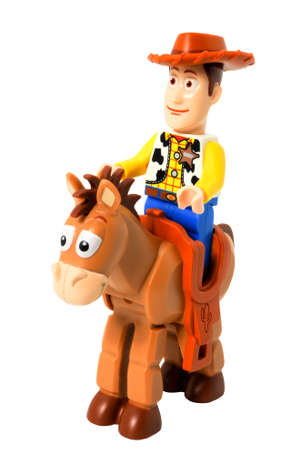 ADELAIDE, AUSTRALIA - April 14 2014:A studio shot of a Woody and bullseye Lego minifigure from the Disney movie series Toy Story. Lego is extremely popular worldwide with children and collectors.