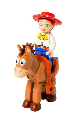 disney: ADELAIDE, AUSTRALIA - April 14 2014:A studio shot of a Jessie and bullseye Lego minifigure from the Disney movie series Toy Story. Lego is extremely popular worldwide with children and collectors.