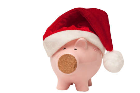 christmas savings: Pink piggy bank with santa hat representing christmas savings Stock Photo
