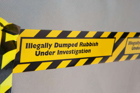 dumping: An illegally dumped item marked with warning tape