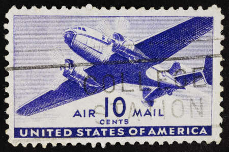 philatelic: USA - Circa 1941:A Cancelled postage stamp from the USA illustrating Transport Plane, issued in 1941. Editorial