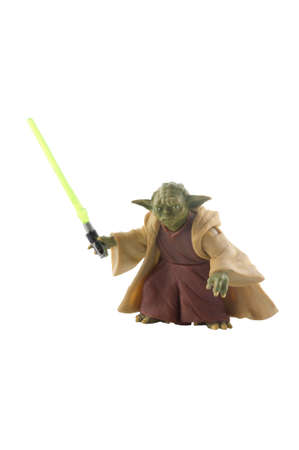 star: ADELAIDE, AUSTRALIA - December 30, 2014: A Studio shot of a Yoda Action figure from the Star Wars Movie Series. Star Wars is one of the most popular movie series of all time.