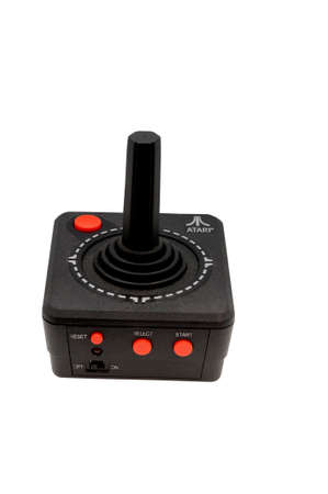 credited: ADELAIDE,AUSTRALIA - October 27 2014:A studio shot of a vintage Atari 2600 Controller. Atari is credited with popularizing microprocessor-based hardware and cartridges with game code