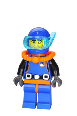 yellow lego block: ADELAIDE, AUSTRALIA - January 09 2015:A studio shot of a Deep Sea Diver Lego minifigure from Minifigure Series 1. Lego is extremely popular worldwide with children and collectors.