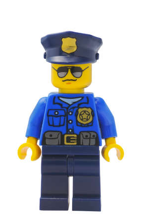 lego: ADELAIDE, AUSTRALIA - January 09 2015:A studio shot of an Policeman Lego City minifigure from the popular Lego Series. Lego is extremely popular worldwide with children and collectors.