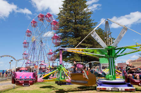 rides: ADELAIDE, AUSTRALIA - December 26 2014: Amusement Rides on the Victor Harbor Foreshore. Victor Harbor is a popular seaside visitor destination in South Australia. Editorial