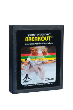 breakout: ADELAIDE, AUSTRALIA - February 06 2015: A Studio shot of an Atari 2600 Breakout Game Cartridge. A popular video game from the 1980s is popular with collectors and retro gamers worldwide.