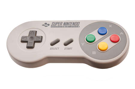 nintendo: ADELAIDE, AUSTRALIA - October 27 2014:A studio shot of a Super nintendo video game controller. A popular 16-bit entertainment system sold worldwide during the 1990s.