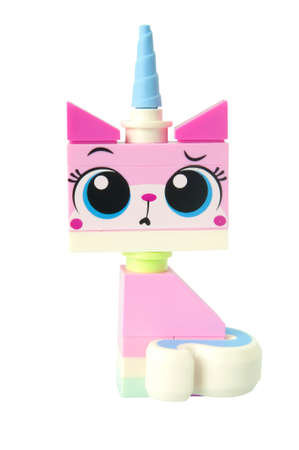 lego: ADELAIDE, AUSTRALIA - March 10 2015:A studio shot of a Unikitty Lego minifigure from the Lego movie. Lego is extremely popular worldwide with children and collectors.