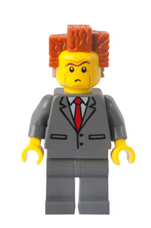 lego: ADELAIDE, AUSTRALIA - March 10 2015:A studio shot of a President Business Lego minifigure from the Lego movie. Lego is extremely popular worldwide with children and collectors.