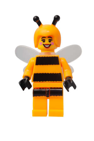 lego: ADELAIDE, AUSTRALIA - March 27 2015:A studio shot of a Bumblebee Girl Lego minifigure. Lego is extremely popular worldwide with children and collectors.