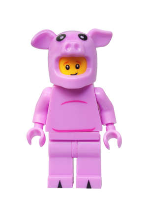 lego: ADELAIDE, AUSTRALIA - March 27 2015:A studio shot of a Piggy Guy Lego minifigure. Lego is extremely popular worldwide with children and collectors.