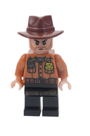 rick: ADELAIDE, AUSTRALIA - April 21 2015:A studio shot of a Rick Grimes Custom Lego minifigure from the Walking Dead. Lego is extremely popular worldwide with children and collectors.