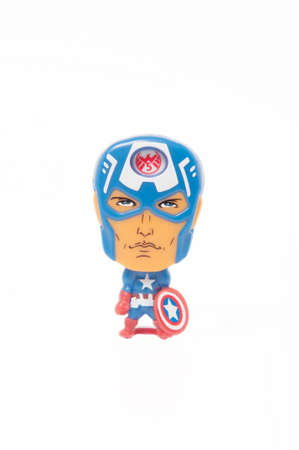 kinder: ADELAIDE, AUSTRALIA - May 22, 2015: A studio shot of a Captain America Kinder Surprise Toy on a white background. Kinder Surprise eggs are a popular treat for children and the toys contained inside are highly sought after collectables.