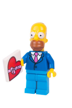 simpson: Adelaide, Australia - June 08 2015: An isolated image of a Homer Simpson Series 2 Lego Minifigure. The Simpsons is the longest running animated TV series of all time. Items from the Simpson and Lego are highly sought after collectables. Editorial