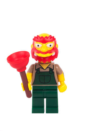 groundskeeper: Adelaide, Australia - June 08 2015: An isolated image of a Willie the Groundskeeper Series 2 Lego Minifigure. The Simpsons is the longest running animated TV series of all time. Items from the Simpson and Lego are highly sought after collectables.